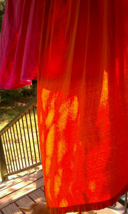 Orange sheets in the breeze