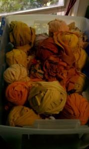Yellow fiber stash, in storage bin