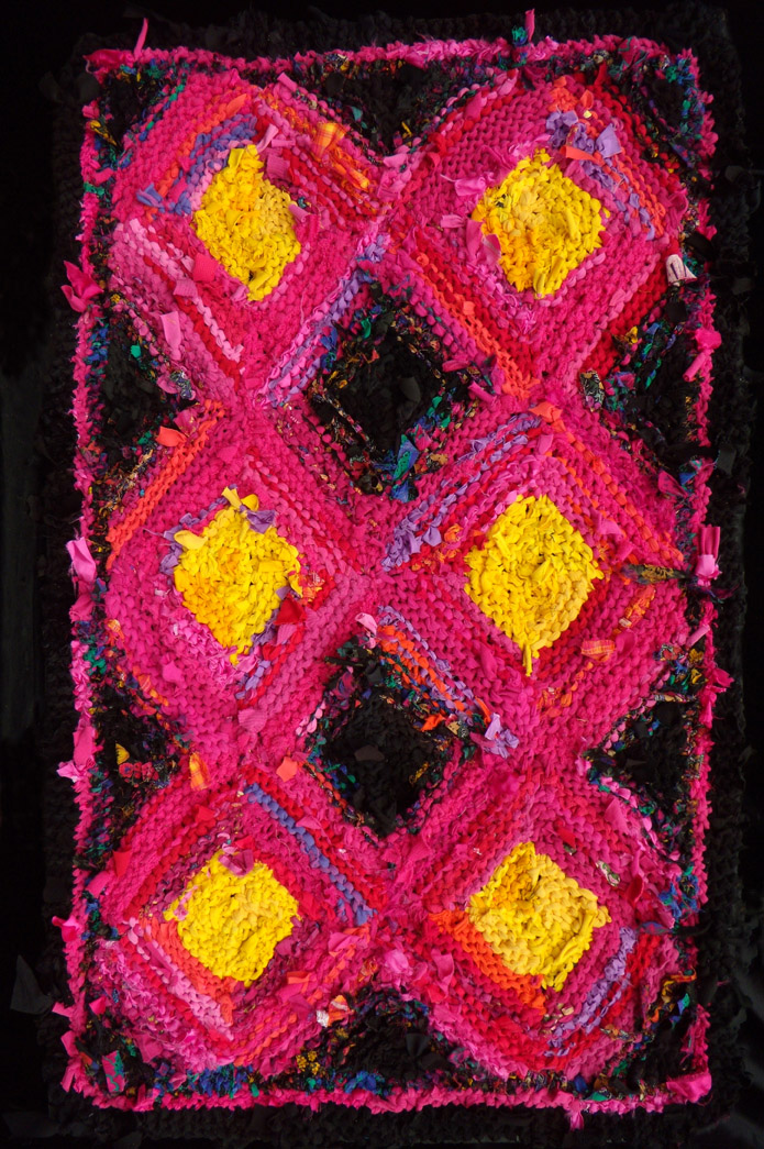 "Pink & Yellow Log Cabin hand knit rug, 56"" x 35""; $990. Pink shades into black-and-pink before going to black. See this and more rugs at www.rugsfromrags...."