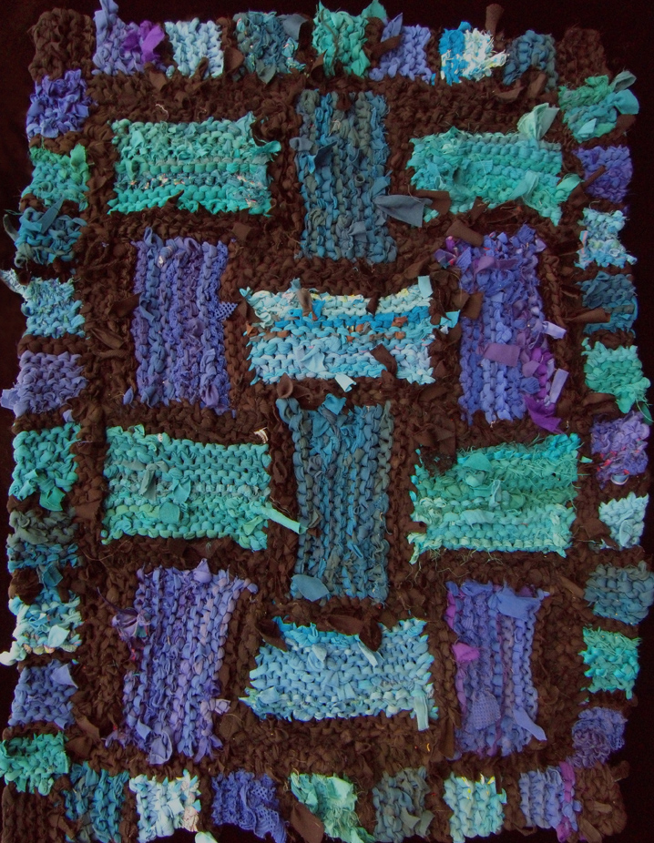 Teal Lattice. Hand knit rag rug, made from recycled t shirts and other clothing. Sold.