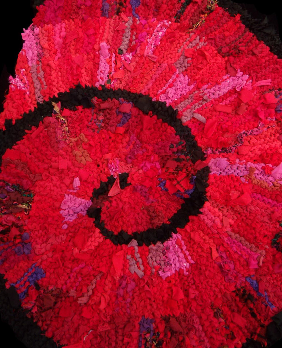 Red Nautilus hand knit rag rug section. $960. See this and more at www.rugsfromrags.com/shop