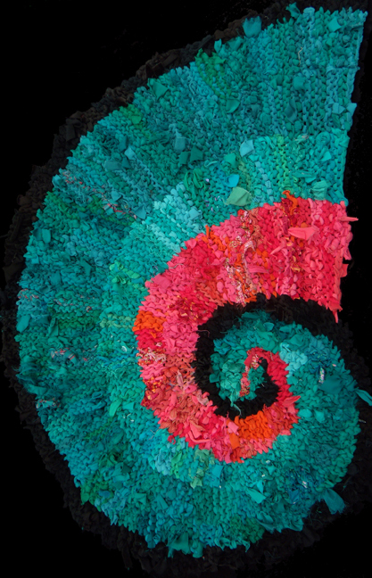 Teal and Peach Nautilus hand knit rag rug, made from #recycled #tshirts and other clothing. See more at www.rugsfromrags.com.