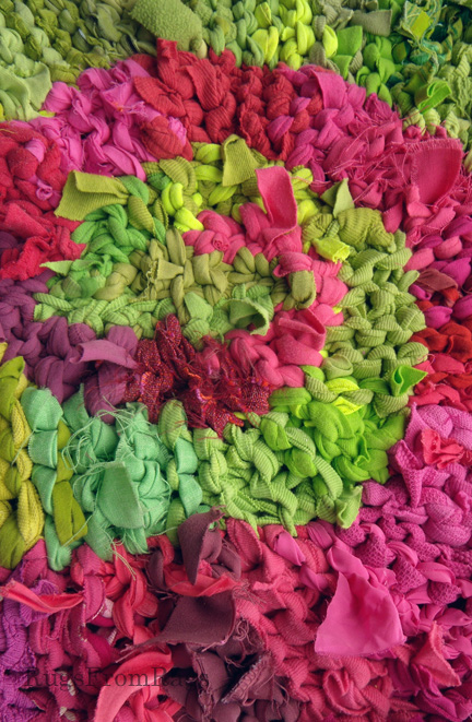Detail of one of the three centers on Pink & Green Triple Spiral rag rug.