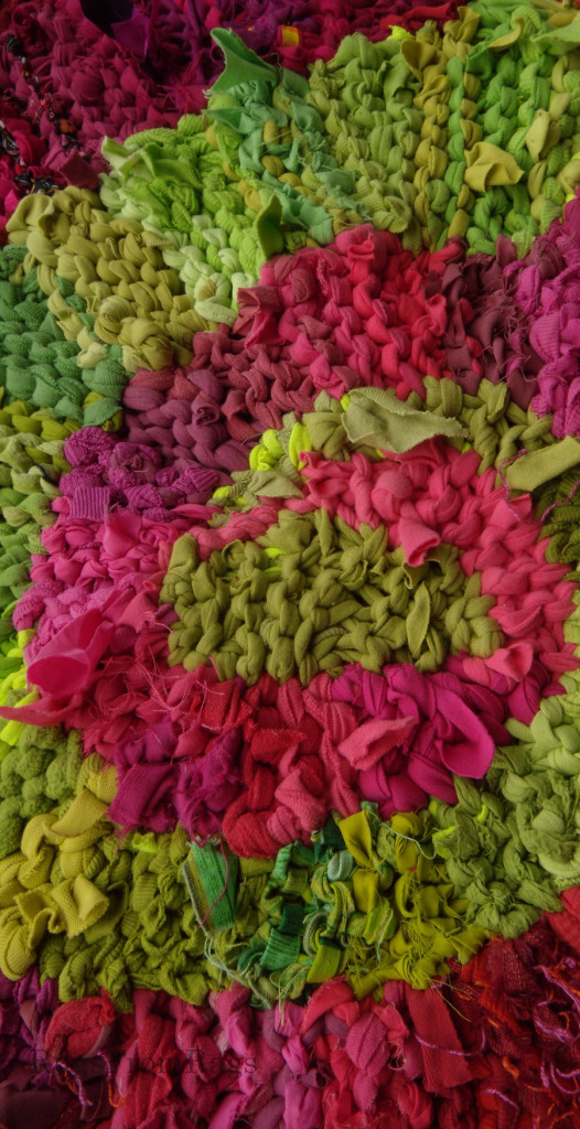 Second center of one of the three spirals in Green and Pink triple spiral rag rug.