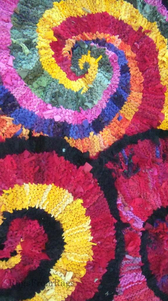 Three spiral rag rugs