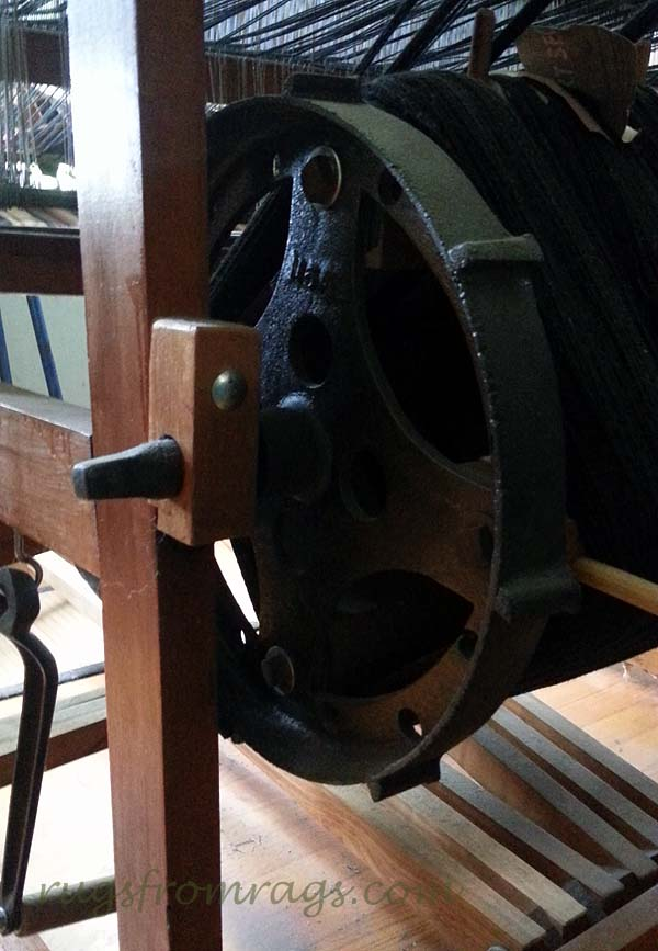 Brake side of the sectional beam; weaver's right. The little ridges are the ratchets that hold the brake bar. The wheel turns about 3 or 4 inches between ratchets.