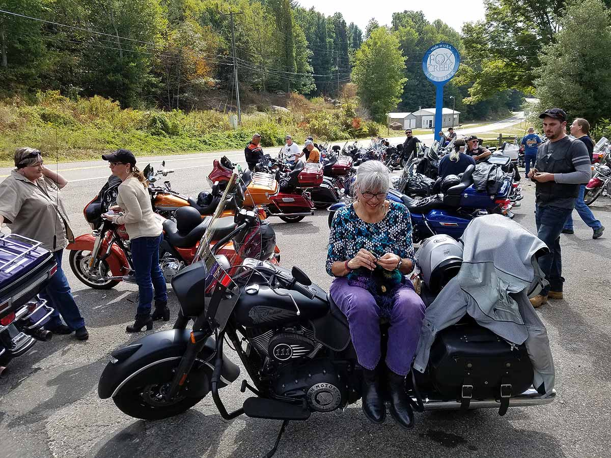 "Knitting while we wait for the ""kickstands up!"" call at the Foxcreek Customer Appreciation Ride."