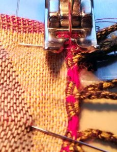 Stitching a halved Pashmina shawl back together.