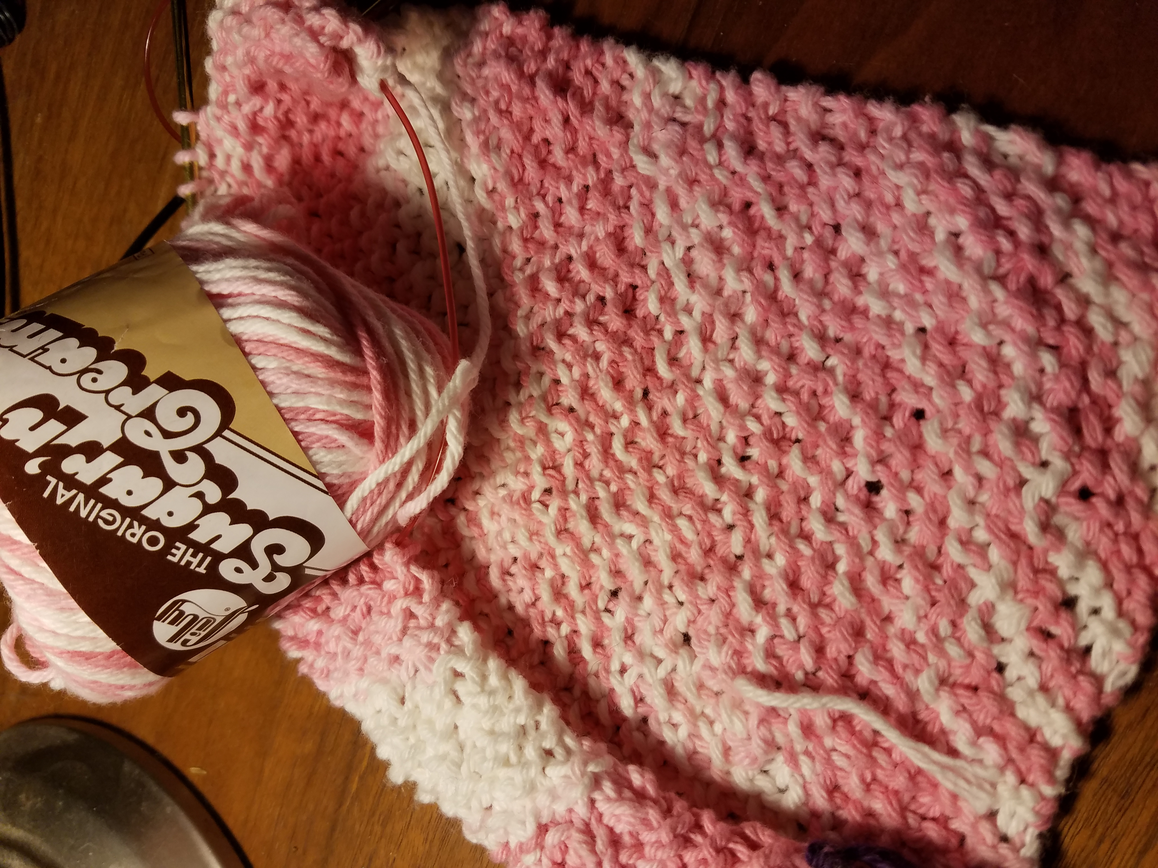 Sugar'n Cream yarn knit in seed stitch.